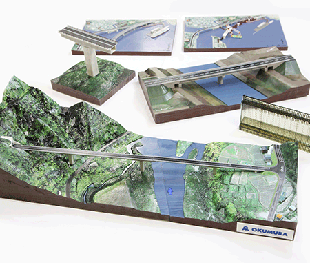 The large bridge model above in front (W75cm x D30cm) was modeled in two parts and takes around 120 hours